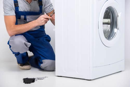 Electrician installing a washing machine