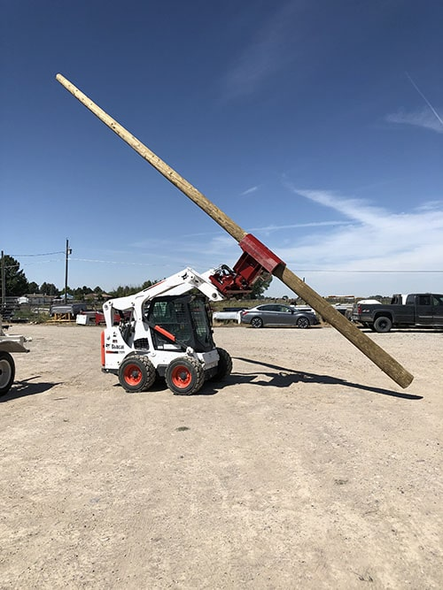 STS Electric crew setting a commercial power pole